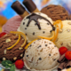 A composition of various flavours ice cream balls decorated with red fruits,chocolate curls and mint